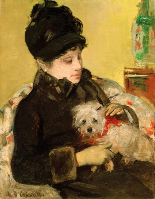 A Visitor in Hat and Coat Holding a Maltese Dog